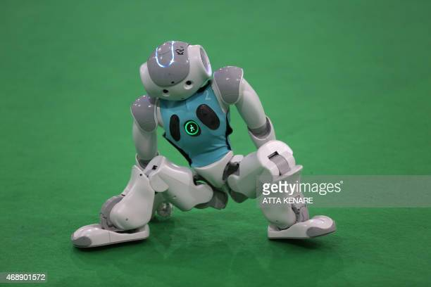 A robot from the Dutch Nao Team from the Van Amsterdam University takes part in a football game against German Nao Team Humboldt from the Berlin...