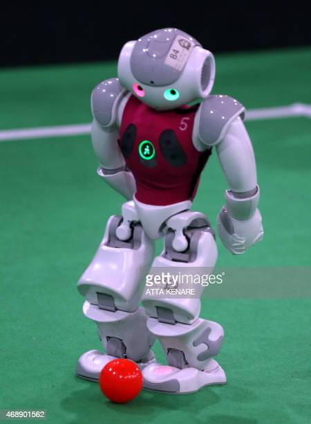 A robot from the German Nao Team Humboldt from the Berlin United University takes part in a football game against Dutch Nao Team from the Van...