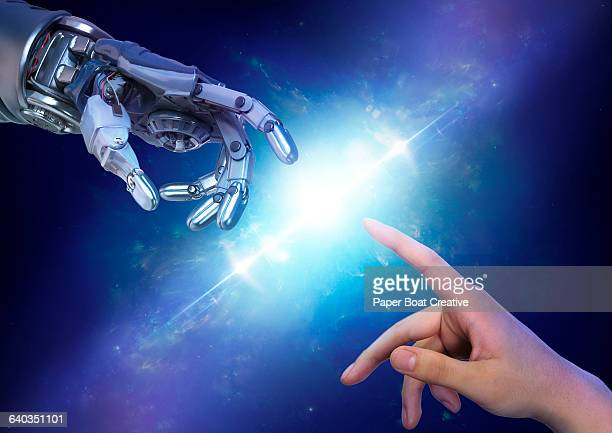 Robot hand close to touching a human hand
