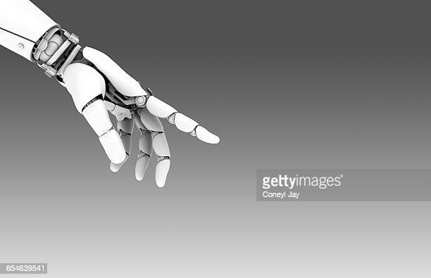 robot hand pointing - robot stock pictures, royalty-free photos & images