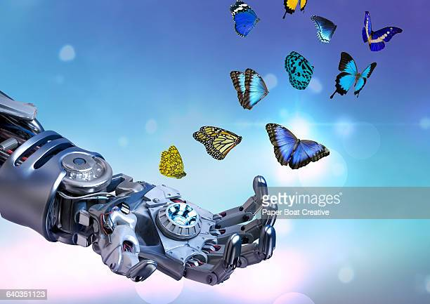Robot hand releasing many blue butterflies