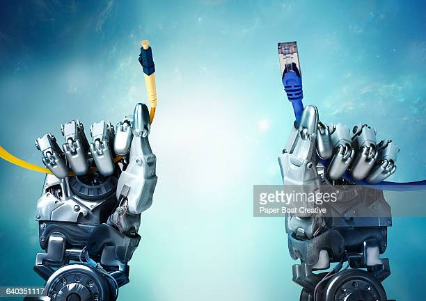 Robot hands holding different internet wires