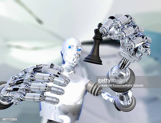 Robot holding up chess piece