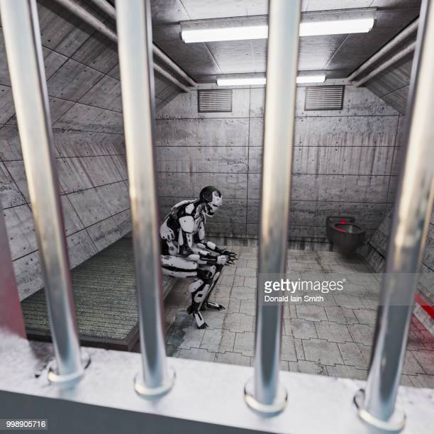 robot in jail cell seen through bars of cell door - ora legale foto e immagini stock