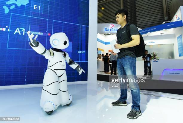 A robot introduces the 5G technology to a visitor during Mobile World Conference 2017 on June 28 2017 in Shanghai China MWC Shanghai themed on 'the...