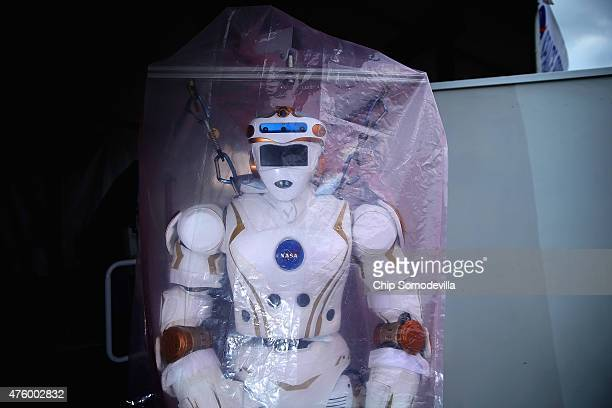 NASA robot is wrapped in plastic before going on display at the Defense Advanced Research Projects Agency Robotics Challenge Expo at the Fairplex...