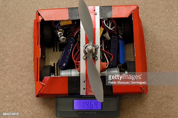 Robot 'Machacabot' is weighed before a sumo robots combat during the Cybertech robotics competition at the the School of Industrial Engineering of...