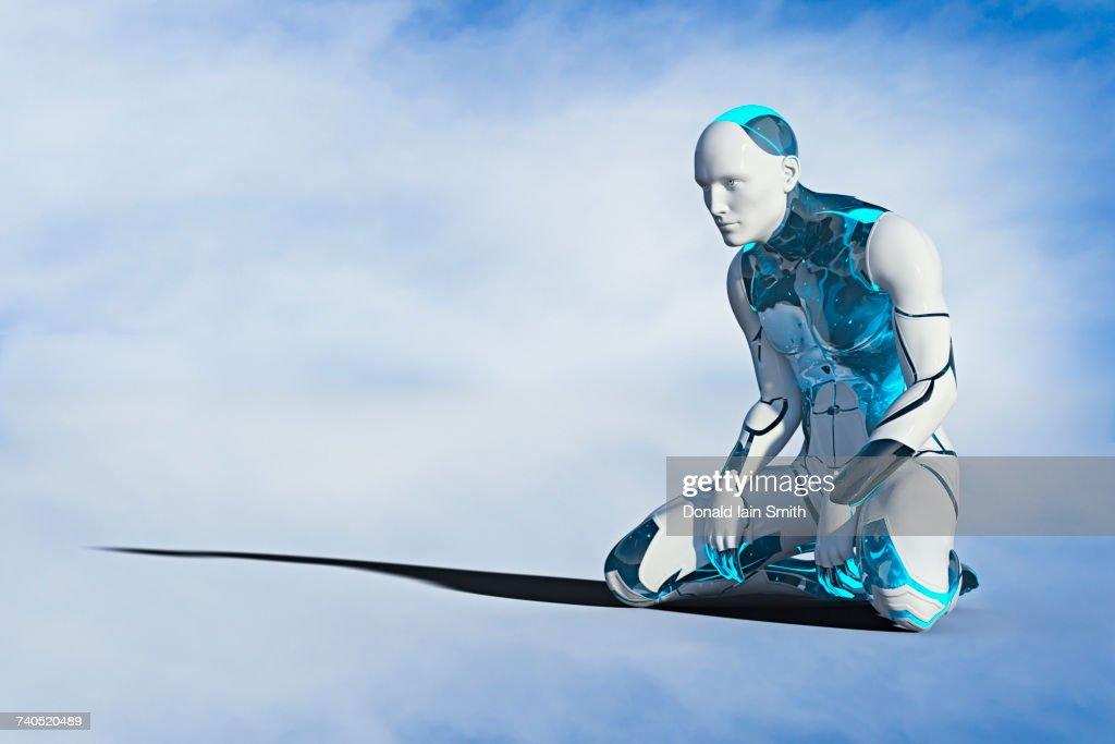 Robot man kneeling on ground : Stock Photo