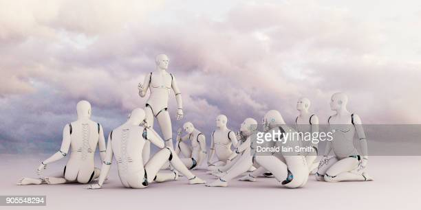 Robot man lecturing sitting robots