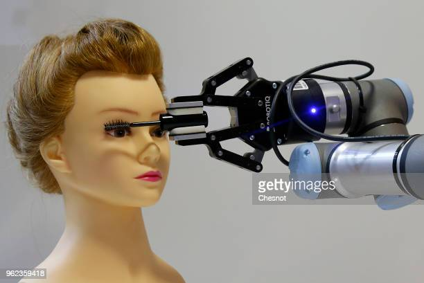 Robot manufactured by French beauty care company L'Oreal applies mascara on a dummy during the Viva Technology show at Parc des Expositions Porte de...