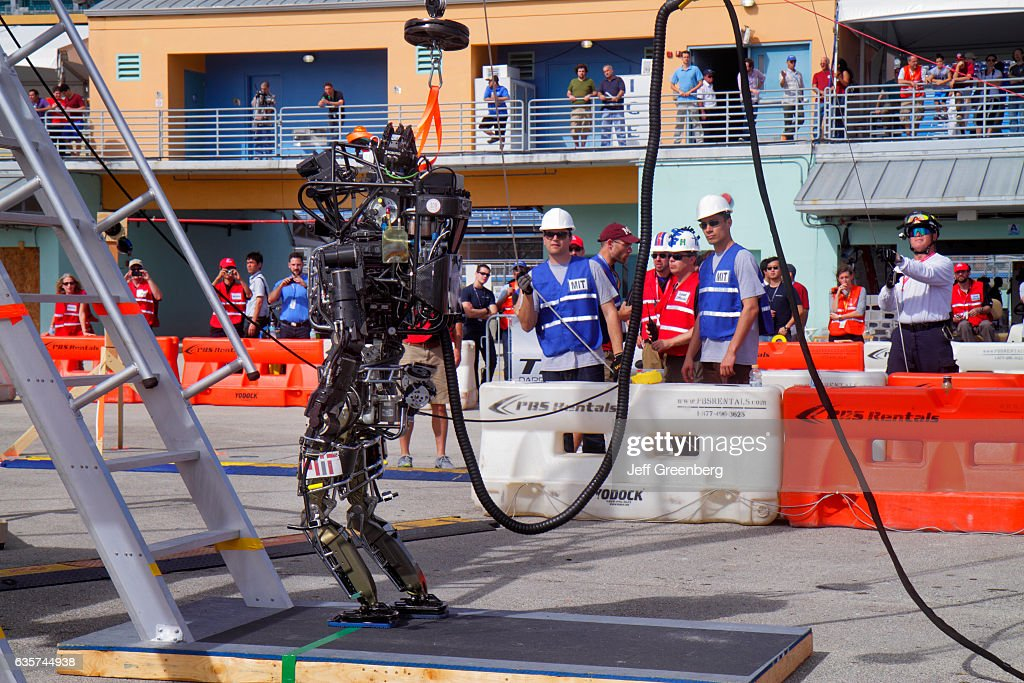 A robot on a climbing ladder task at the DARPA Robotics Challenge Trials. : News Photo