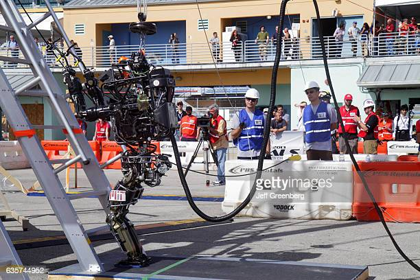 A robot on a climbing ladder task at the DARPA Robotics Challenge Trials