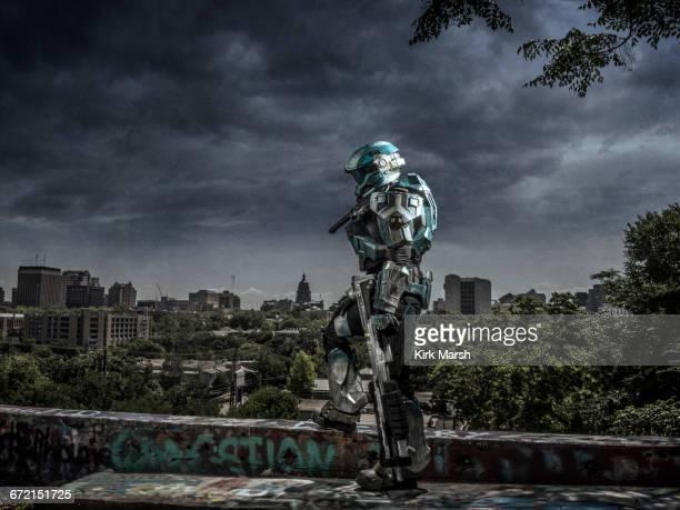 Robot patrolling city holding rifle