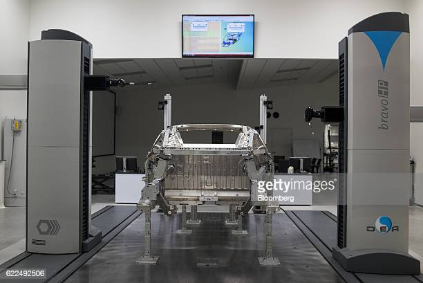 A robot performs a dimensional inspection on the chassis of a Honda Motor Co 2017 Acura NSX vehicle at the Honda Performance Manufacturing Center in...