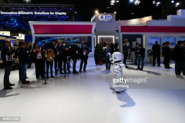 A robot performs dance moves as its demonstrates 5G connectivity capabilities on the China Mobile stand on the second day of Mobile World Congress in...