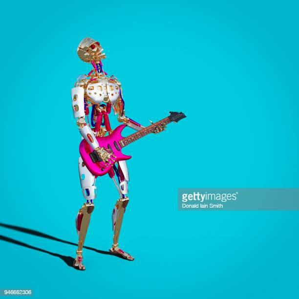 Robot playing electric guitar