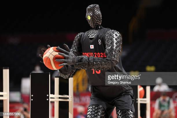 Robot plays basketball during halftime of the Men's Preliminary Round Group B game between the United States and France on day two of the Tokyo 2020...