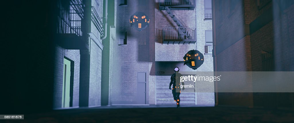 Robot police with drones patrolling the streets at night : Stock Photo