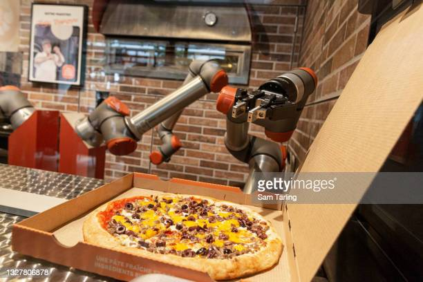 Robot prepares a pizza at Paris's first robotic pizzeria, on July 9, 2021 in Paris, France. The Pazzi outlet is the company's second in France. The...