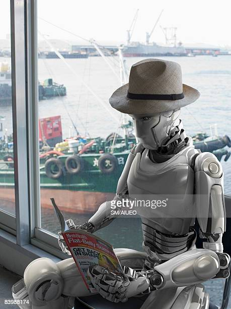 Robot reading a magazine