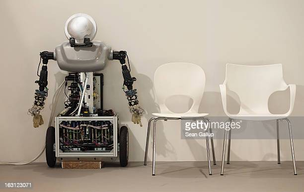 A robot rests next to empty chairs at the Poland country stand at the 2013 CeBIT technology trade fair on March 5 2013 in Hanover Germany CeBIT will...
