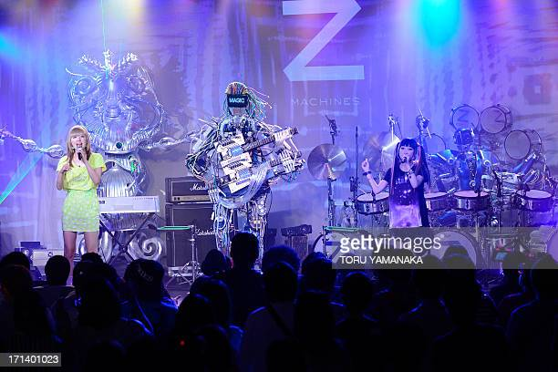 Robot rock band 'ZMACHINES' performs with Japanese pop duo AMOYAMO during its debut concert in Tokyo on June 24 2013 The robot band consists guitar...