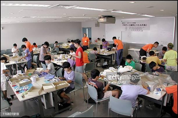 Robot School For Children In Summer In Tokyo Japan On July 24 2000 Robot school for children in summer Prof Akira Sato of Shibaura Industrial...