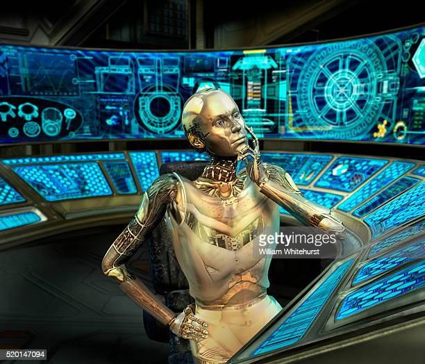 Robot Sitting at Control Panel