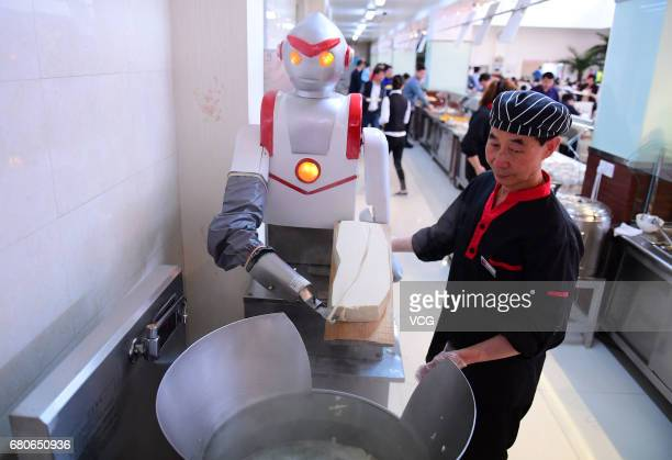 A robot slices noodles for students at Shenyang Agricultural University on May 9 2017 in Shenyang Liaoning Province of China Sliced noodles made by...