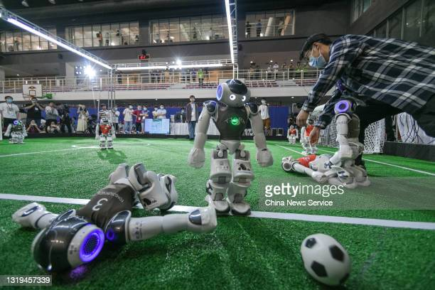 Robot soccer players compete in a soccer game during the 2021 RoboCup China Open, also the RoboCup Asia-Pacific Tianjin Invitation Tournament, which...
