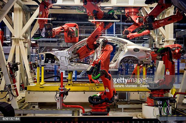 A robot stands in the Body Shop where they assemble the Alfa Romeo Giulia in the Cassino Assembly Plant FCA Group This is the most highlyautomated...
