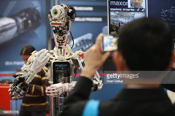 A robot stands on display at the Maxon Motor stand at the Hannover Messe 2013 industrial trade fair on April 8 2013 in Hanover Germany The Hannover...