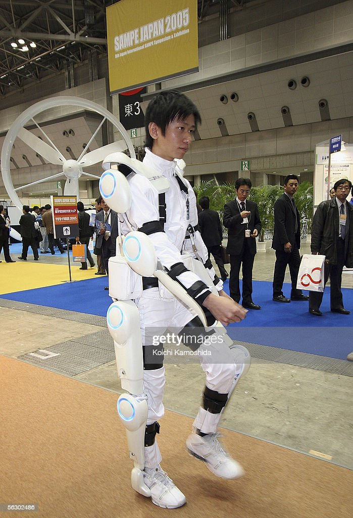 Robot suit 'Hybrid Assistive Limb (HAL)' worn by a man developed by University of Tsukuba is seen during 2005 International Robot Exhibition on November 30, 2005 in Tokyo, Japan. By wearing the power suit, it makes it easier to move and lift heavy things. The Exhibition is on until December 3.