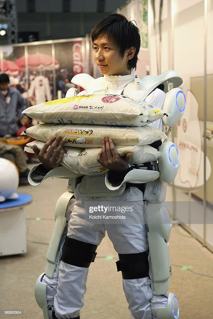 Robot suit 'Hybrid Assistive Limb (HAL)' worn by a man developed by University of Tsukuba is seen lifting a 30kg weight during 2005 International Robot Exhibition on November 30, 2005 in Tokyo, Japan. By wearing the power suit, it makes it easier to move and lift heavy things. The Exhibition is on until December 3.