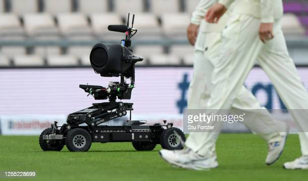 A robot television camera follows the players on to the field during day two of the 1st #RaiseTheBat Test match at The Ageas Bowl on July 09 2020 in...