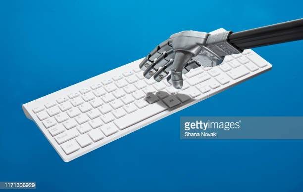 "robot types on keyboard - ""shana novak"" stock pictures, royalty-free photos & images"