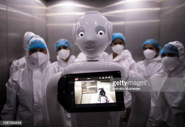 """Robot used to assist Covid-19 patients is seen in an elevator on December 5, 2020 in New Delhi, India. The """"Mitra"""" robot can connect patients with..."""