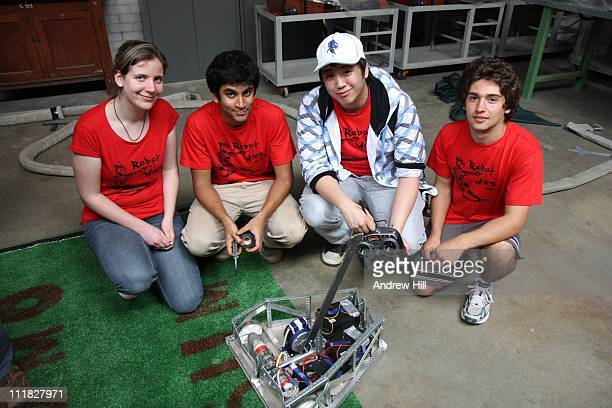 Robot Wars Competition. Group of competitors with their remote controlled robot.