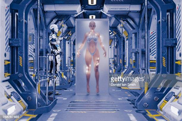 Robot watching woman in suspended animation