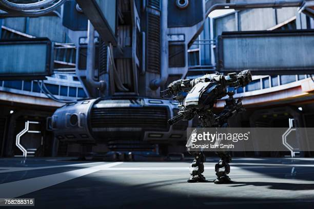 Robot with guns in futuristic city