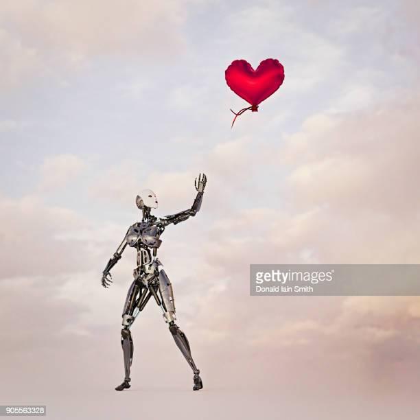 Robot woman releasing heart-shape balloon into the sky