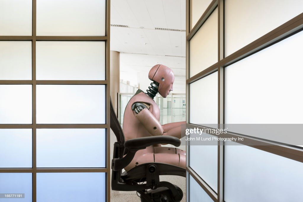 Robot working in office : Stock Photo