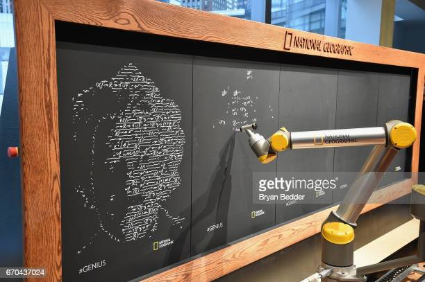 A robot writes on a chalkboard at National Geographic's Further Front Event at Jazz at Lincoln Center on April 19 2017 in New York City