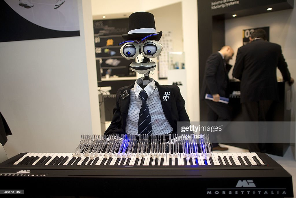 A roboter plays piano at the Morsettitalia stand at the Hannover Messe industrial trade fair on April 10, 2014 in Hanover, Germany. The Netherlands is the official partner Country of this year's fair with more than 5000 companies showcasing their latest industrial products and solutions. The Hannover Fair will run from April 07-11.