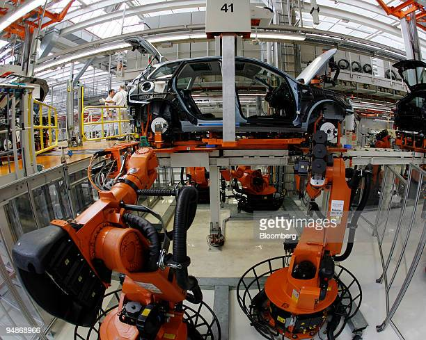 KUKA roboters assemble an Audi A3 automobile at the Audi factory in Ingolstadt Germany on Tuesday April 1 2008 Audi AG Volkswagen AG's luxury auto...