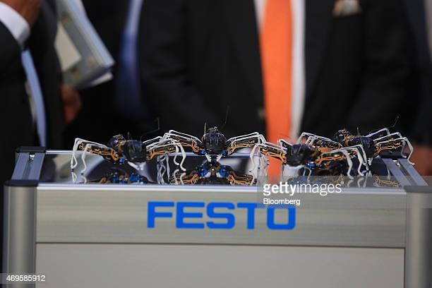 Robotic ants manufactured by Festo KG sit on display on the Festo exhibition stand at the Hanover industrial fair in Hanover Germany on Monday April...