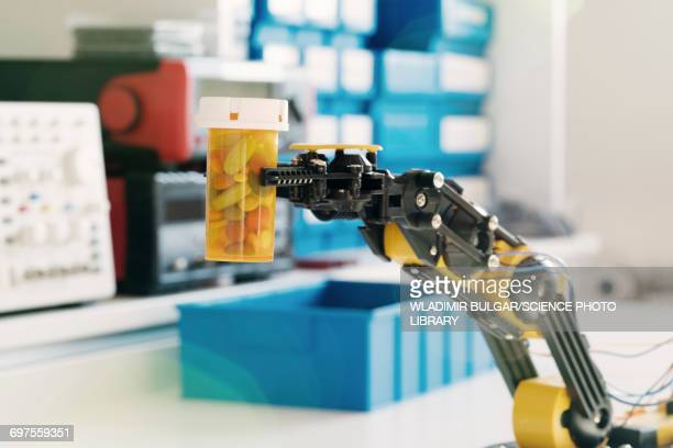 Robotic arm and bottle of pills