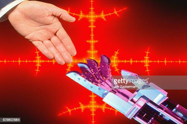 Robotic Arm and Businessman's Hand