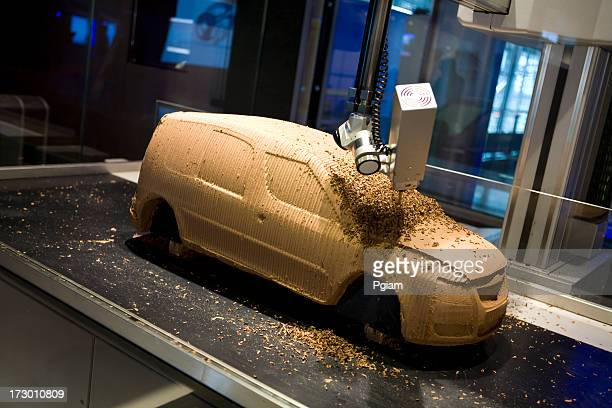 Robotic arm crafting a car