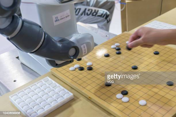 A robotic arm developed by Shenzhen AiThinker Technology CO LTD plays chess during the 2018 World Artificial Intelligence Conference at West Bund on...